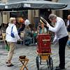 Organ grinder greets tourist.