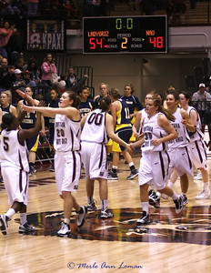 Lady Griz celebrate the win, NAU doesn't look so happy (in the background)