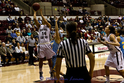 Sarah Ena making a basket, Carly Selvig coming in to help