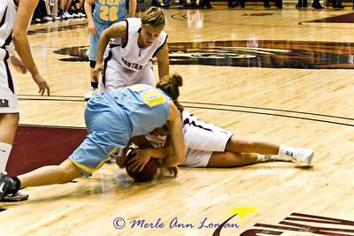 Stephanie Stender on the floor, Lexie Nelson ready to help