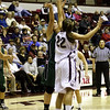 Katie Baker going up to alter a shot.
