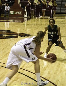 """Kenzie just stole the ball and is being """"eyed"""" by North Dakota's guard. She is trying to figure out how to stop Kenzie. It didn't happen."""