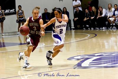 Lexie bringing the ball down the floor.