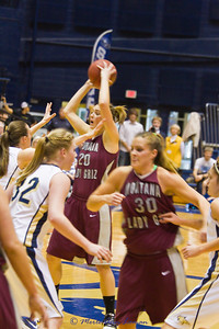 Jessa Loman Linford  with the ball looking over the defense and Steph Stender gaining position