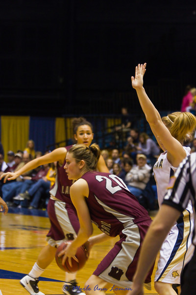 Jessa Loman Linford with the ball, Sara Ena looking on.