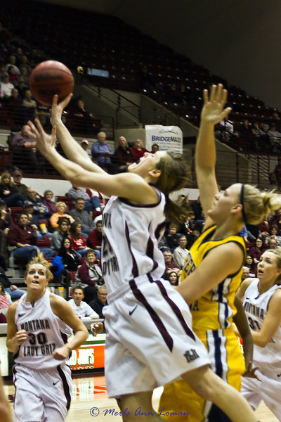 Jessa Loman Linford going to the basket, Steph Stender #30 looking on