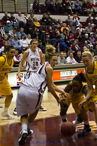 Jordan Sullivan trying to recover the basketball, Jessa Loman Linford #20 looking on