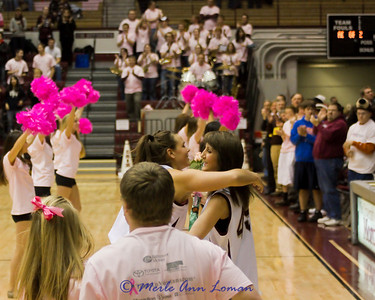 Jill Valley - breast cancer survivor and much loved local news anchor at the Lady Griz game in Dahlberg Arena, Missoula, MT, Feb 24, 2011. Lady Griz Aylssa Smith presented roses to Jill and is giving her a hug.