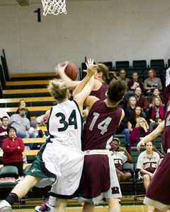 Ali Hurley with a rebound, Sarah Ena #14 is trying to help