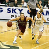Alyssa Smith bringing the ball up the floor.