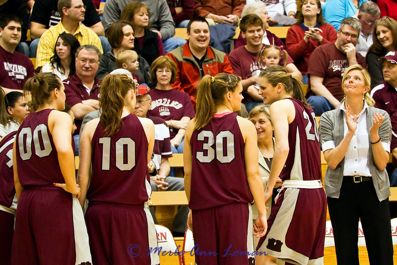 before the game. Jessa #20 is leading the intense growling pre-game session.