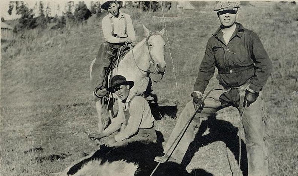 Amyx boys branding cattle on Provoncher homestead on Blanco. Dean on horse, Mark on cattle, Ruby holding branding iron.