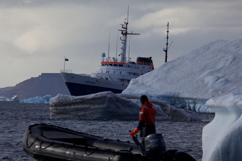 This photo really gives you some perspective on the size of icebergs compared to a large ship and a small zodiac.