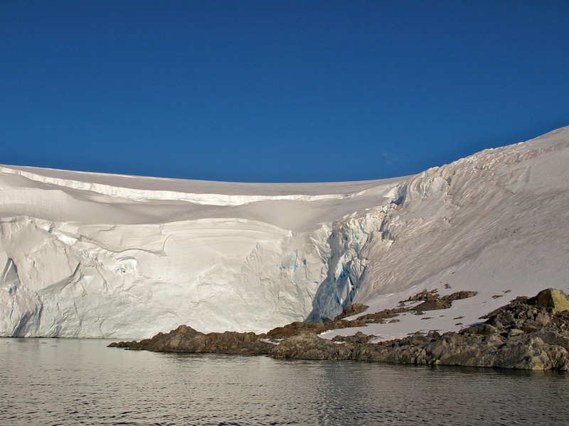 Large glaciers surround Port Lockroy.  Due to global warming, they could pose a risk should they start to calve.