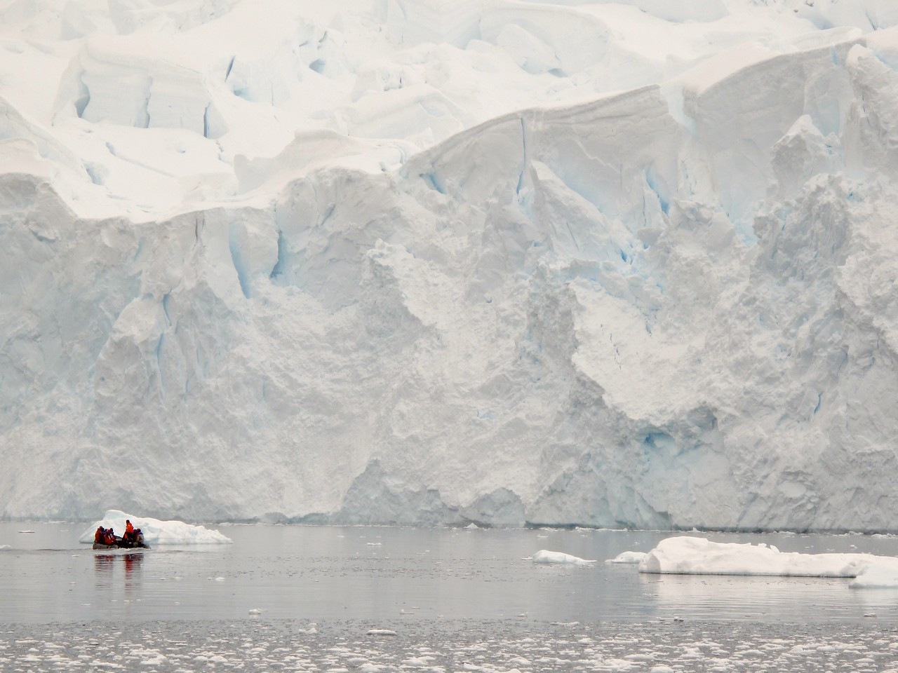 Let's hope this glacier stays in place while the zodiac sails by.