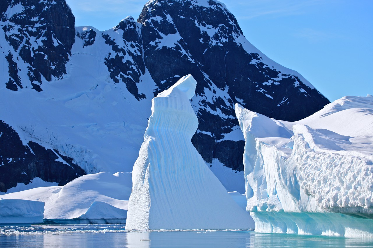 At the base of many of the icebergs, you can see how the level of water changes throughout the day with the tide.