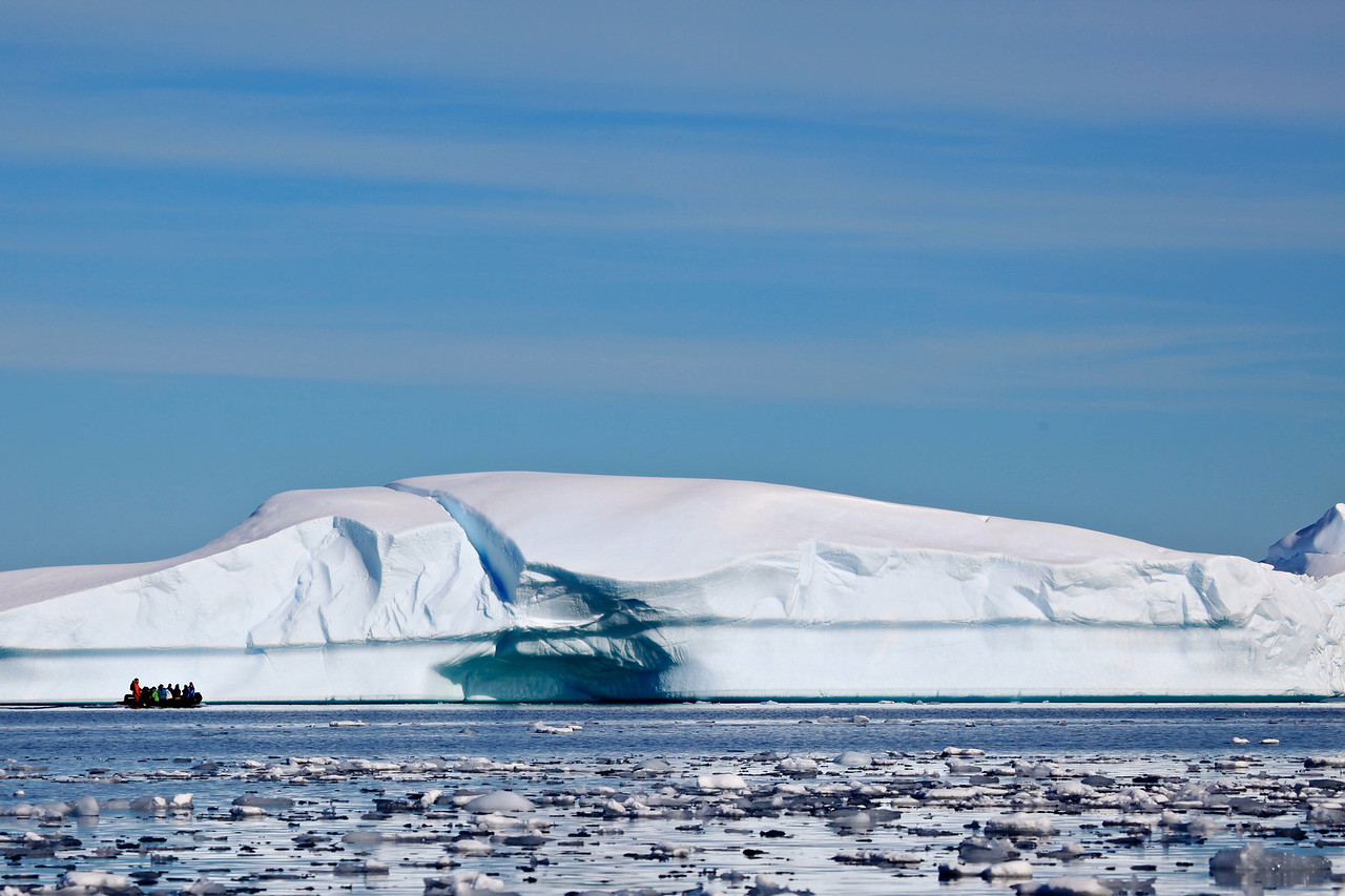 This photo really puts the scale of many of the icebergs into perspective.