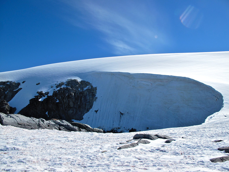 Wind erosion has swept the corners of this glacier to form almost a perfect bowl.