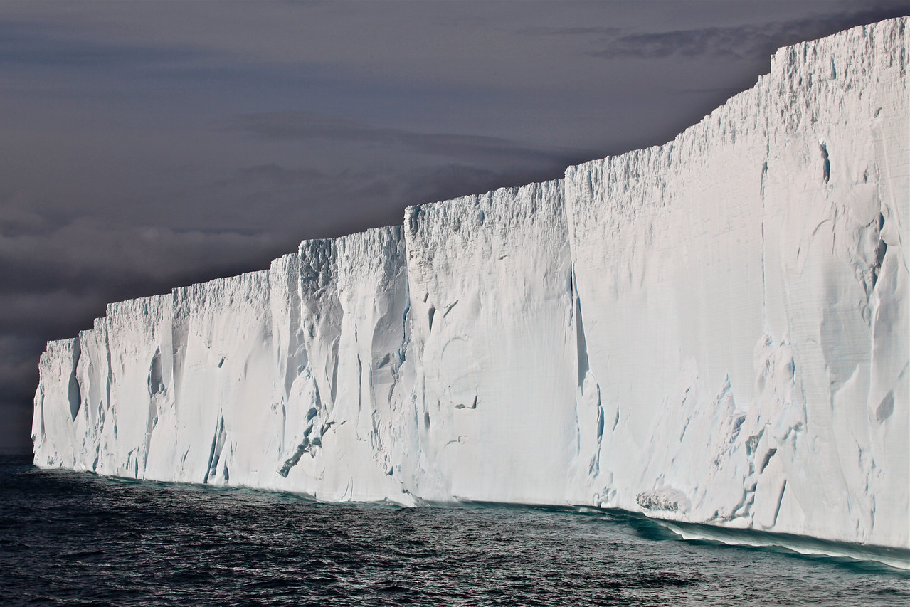 The largest remaining piece of it, Iceberg B-15A, with an area of 3,000 km², was still the largest iceberg on Earth until it ran aground and split into several pieces October 27, 2005. It has been determined that the cause of the breakup was an ocean swell generated by an Alaskan storm 6 days earlier and 13,500 kilometers (8,370 miles) away.