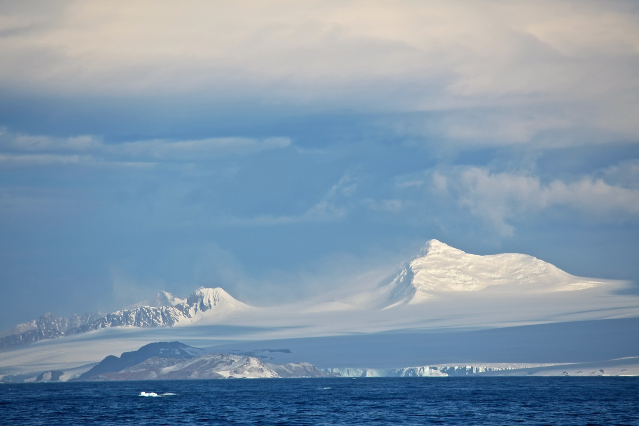 The Transantarctic Mountains were first seen by Captain James Ross in 1841 from the Ross Sea. The range is a natural barrier that must be crossed to reach the South Pole from the Ross Ice Shelf. In 1908, while not making the pole, Ernest Shackleton's party was the first to cross the mountains, using the Beardmore Glacier