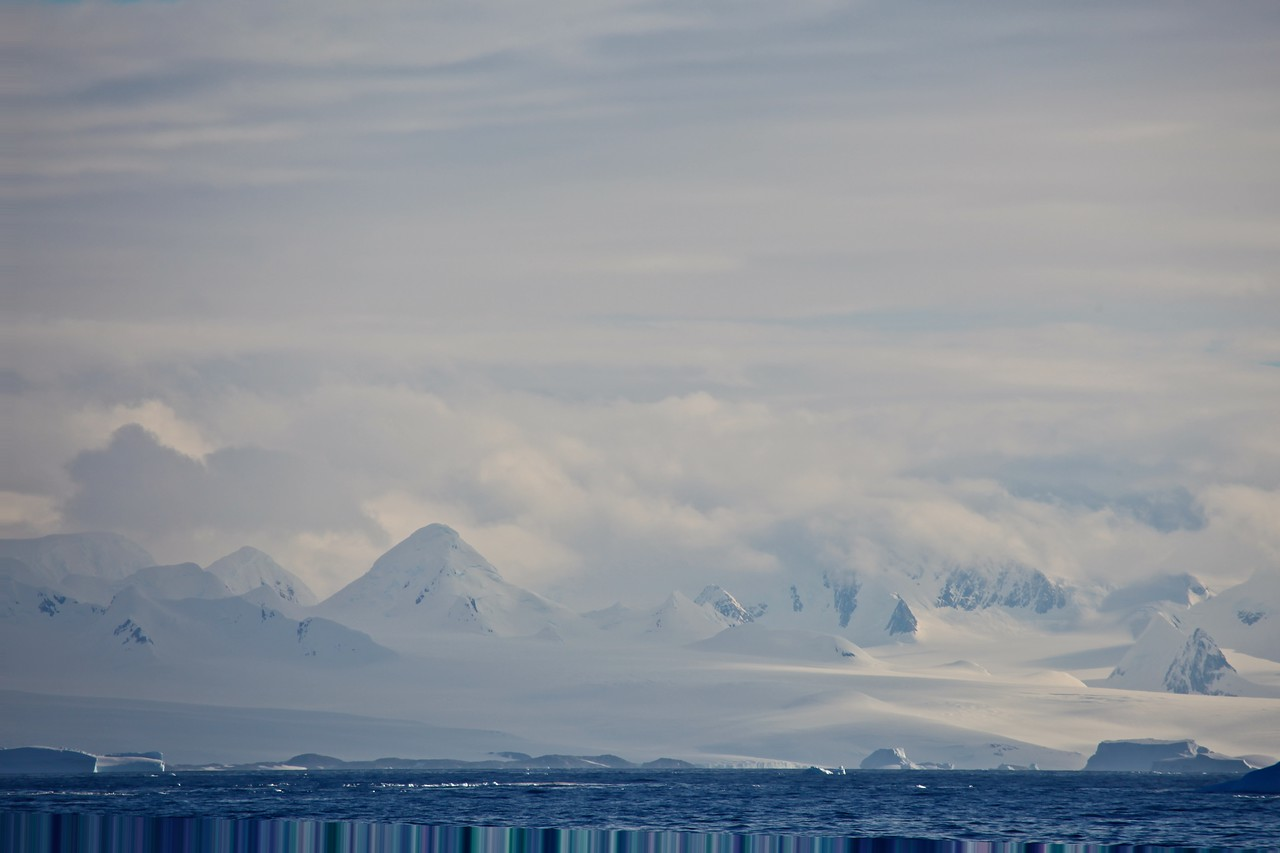 The Antarctic has one of the longest mountain chains in the world, the Transantarctic Mountains that extend from the tip of the Antarctic Peninsula to Cape Adare, a distance of 3000 miles. In many places the chain is mostly buried, but the exposed peaks often have steep snow free faces.