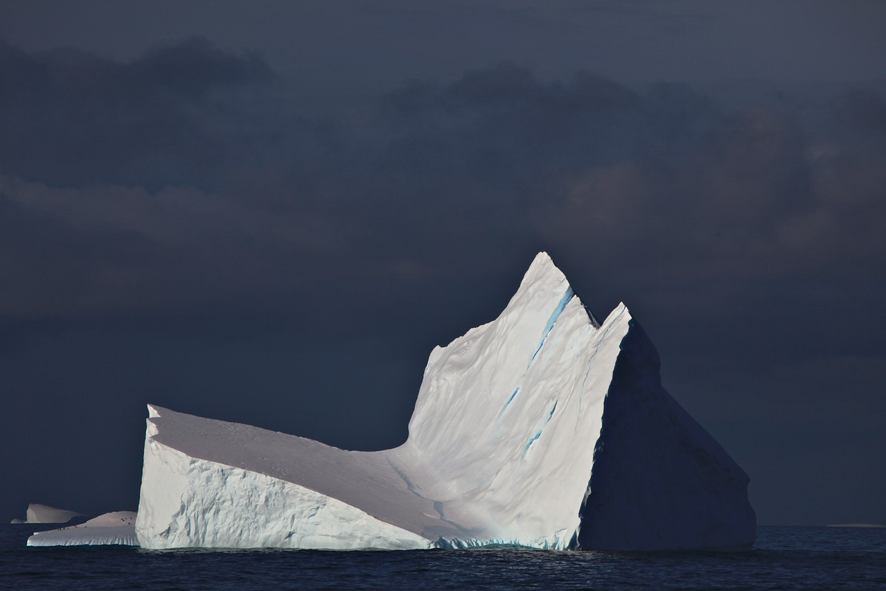 Because the density of pure ice is about 920 kg/m³, and that of sea water about 1025 kg/m³, typically only one-tenth of the volume of an iceberg is above water.