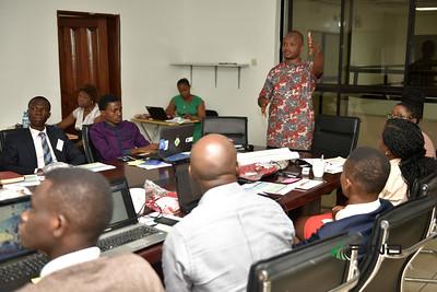 Facilitator John Onyeukwu leading the session