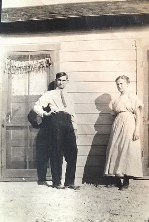 Aurthuar LeCoump  and Agnes Sedy LeCoump in McGill Nevada in front of their house.