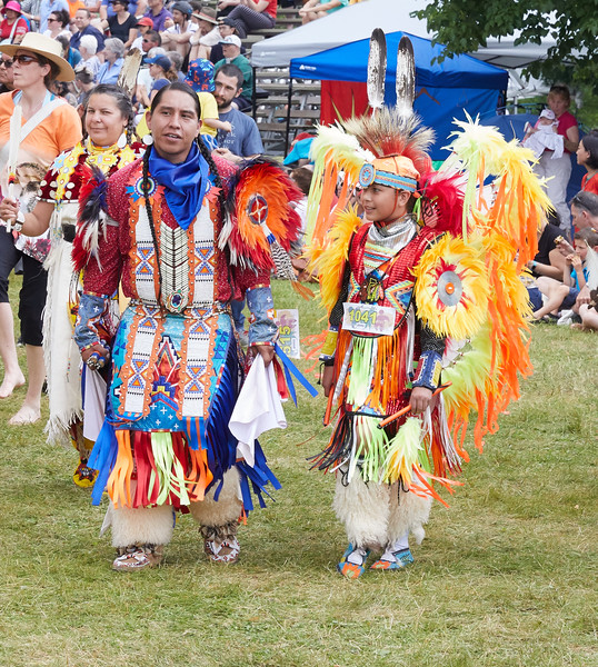 Indigenous Peoples Pow Wow father and son dancers