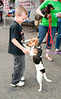 This pooch was dumped in a parking lot before making her way to a rescue organization. <br /> She was very skittish around adults - but when she saw this young boy she gravitated towards him like a moth to a light!