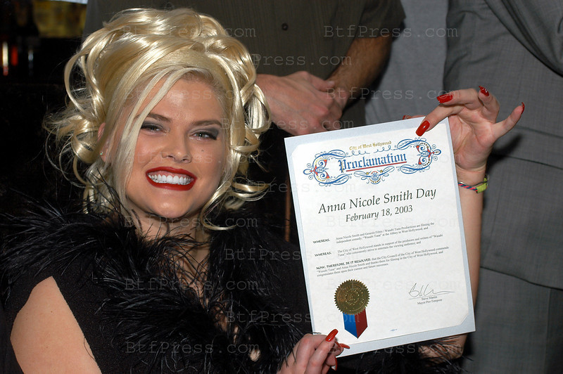 "West Hollywood,CA - FEBRUARY 18 : Playmate Anna Nicole Smith, poses with Drag Queens during the celebration of the city of West Hollywood to declare February 18 ,2003 "" Anna Nicole Smith Day"" in conjonction with a  Drag Queen cast call for the Genesis Films production of Wasabi Tuna at the Abbey on  February 18, 2003 in West Hollywood , California. Vickie Lynn Marshall (November 28, 1967 Ð February 8, 2007), better known under the stage name of Anna Nicole Smith,[1] was an American model, sex symbol, actress and television personality. She first gained popularity in Playboy, becoming the 1993 Playmate of the Year. She modeled for clothing companies, including Guess jeans and starred in her own reality TV show, The Anna Nicole Show. Born and raised in Texas, Smith dropped out of high school and was married at the age of 17. Her highly publicized second marriage to oil business executive and billionaire J. Howard Marshall, 63 years her senior, resulted in speculation that she married the octogenarian for his money, which she denied. Following his death, she began a lengthy legal battle over a share of his estate; her case, Marshall v. Marshall, reached the U.S. Supreme Court on a question of federal jurisdiction. In the months before her death, she was the focus of renewed press coverage surrounding the death of her son, Daniel Smith, and the paternity and custody battle over her daughter Daniellynn."