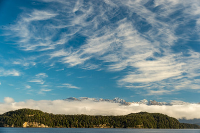 Doubtful Sound in Fjordland. The snow-capped mountains hold low clouds in the valleys. The high clouds were icing on the cake.