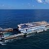Reefworld pontoon, damaged by Cyclone Debbie being towed to Brisbane for repair