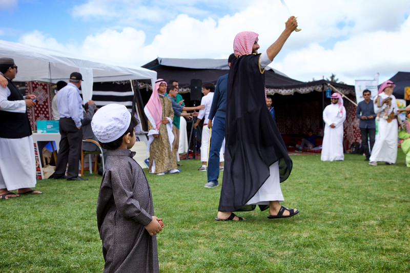 Little boy intrigued by swordsman at the Saudi Arabia tent of the Auckland Cultural Festival