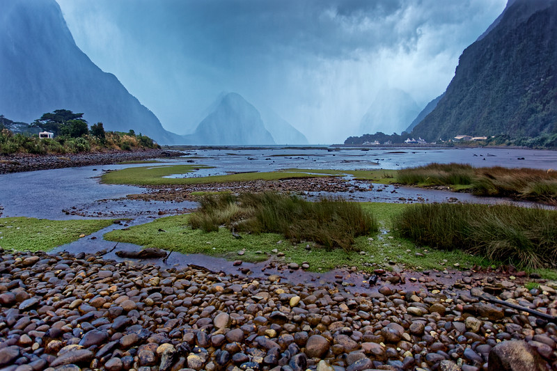 Rain sweeps in over Milford Sound in Fiordland National Park, one of the wettest places on earth