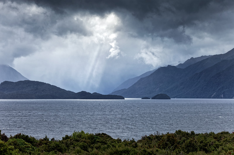 Sunburst on a stormy day at Lake Te Anau, Fiordland