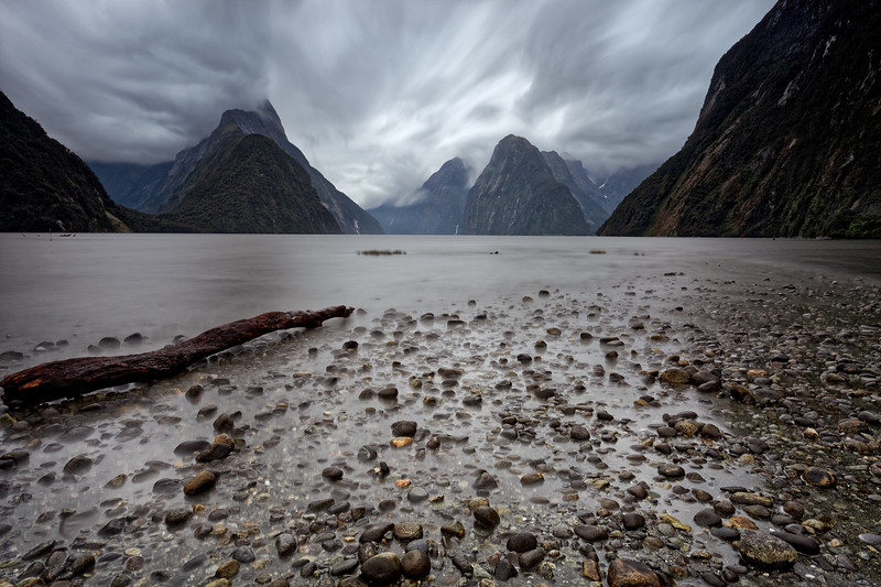 rain clouds sweep in over Milford Sound in Fiordland National Park