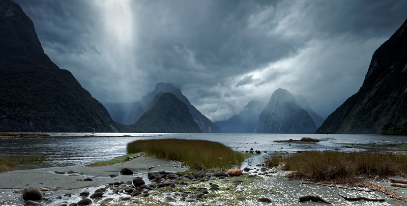 Sunbeam breaks through over Mitre Park in Milford Sound, Fiordland National Park