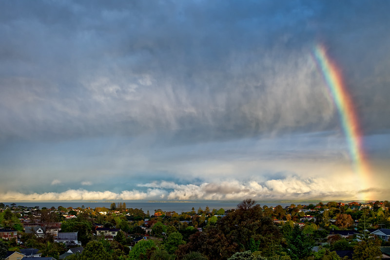 Rain clouds clear over Torbay on the North Shore of Auckland
