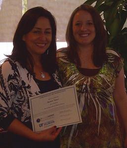 Sandra Tobon, from Hispanic Unity, receives her Master Money Mentor Certificate.