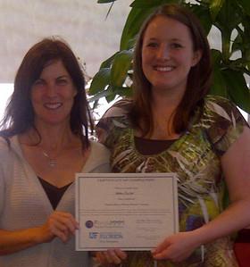 Abby Fuller receives her Master Money Mentor Certificate.