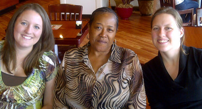 Selena Garrison, Shirley Woods, and Shirlee Mariani enjoy a moment together during the On The Menu lunch.