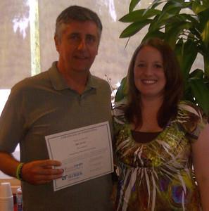 Ken Smith receives his Master Money Mentor Certificate.