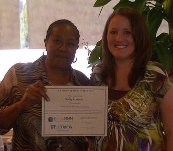 Shirley Woods receives her Master Money Mentor Certificate.