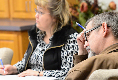 Kevin Harvison   Staff photo Listening to ideas during the the monthly Superintendents' Meeting at the Kiamichi Technology Center Friday.