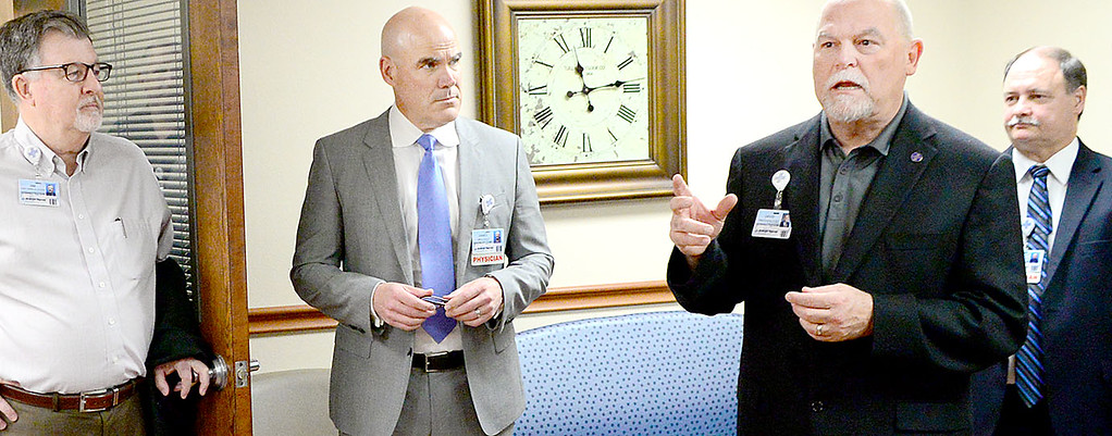 Kevin Harvison   Staff photo Pictured second from right, CEO and President of the McAlester Regional Health Center speaks during a Ribbon Cutting Ceremony for the Urologic Specialists at Southeast Clinic Thursday.