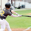 Kevin Harvison | Staff photo<br /> McAlester Buffalo batter Jacob Thomas puts the ball in play during a home win against Spiro Saturday at Mike Deak Field.
