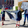 Kevin Harvison | Staff photo<br /> McAlester teachers and students hold signs in front of the Carl Albert Federal Building Wednesday and waves to vehicles as they acknowledge the group.