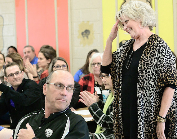 Kevin Harvison | Staff photo<br /> Long time McAlester Public Schools employee Debbie Watkins salutes MPS Superintendant Randy Hughes after he acknowledges her retirement during Monday nights MPS School Board meeting at William Gay Elementary School.