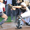 Kevin Harvison | Staff photo<br /> McAlester Buffalo catcher Robbie Waldron tags the second runner in the same play out at home during varsity action against the Ada Cougars Thursday at Mike Deak Field.